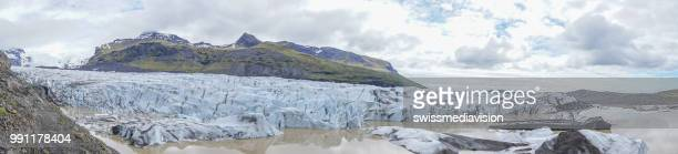 Spectacular view of glacier lagoon in Iceland with icebergs floating on water, overcast day