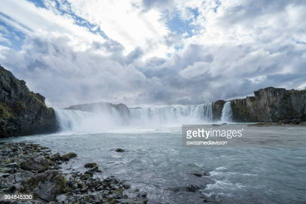 Spectacular view of Godafoss waterfalls in Iceland, overcast day, water mist