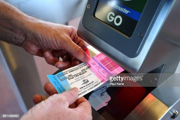 A spectaor scans his ticket for entry during the Twenty20 match between the Perth Scorchers and England Lions at Optus Stadium on December 13 2017 in...