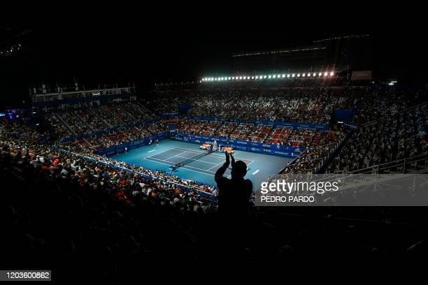 TOPSHOT A spectator aplauds during the Mexico ATP Open 500 men's singles tennis match between Bulgaria's Grigor Dimitrov and France's Adrian...