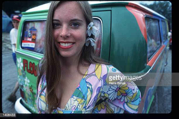 A spectator attends the Woodstock 25th anniversary concert August 13 1994 at Winston Farm in Saugerties NY An international media event that helped...