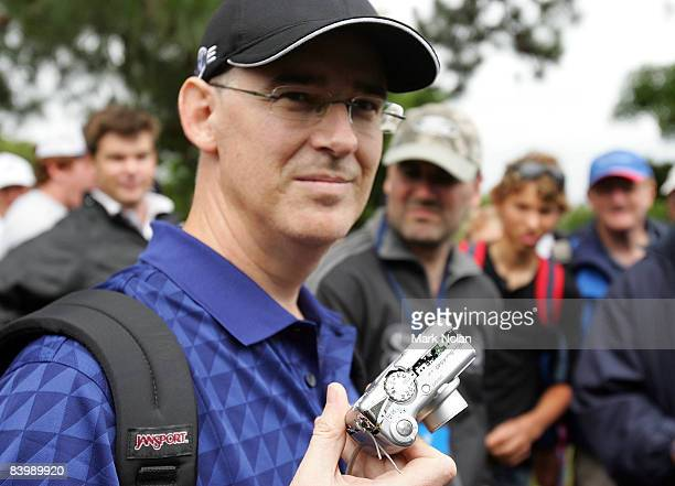 Spectator Brad Clegg displays his camera that was thrown against a tree by John Daly of the USA on the ninth hole during the first round of the 2008...