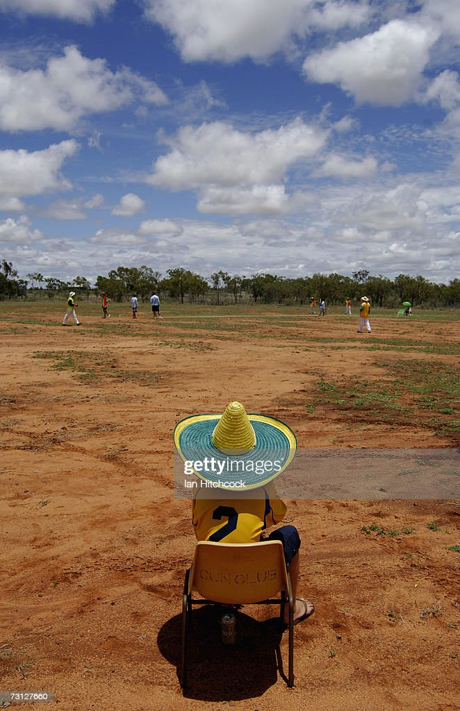 Spectator Brody Curran watches a social grade of cricket during the Goldfield Ashes January 27, 2007 in Charters Towers, Australia. Due to heavy overnight rain the three day cricket carnival was cancelled however several teams still came out and played. Every Australia Day weekend the small outback town of Charters Towers in North Queensland hosts a cricket carnival named 'The Goldfield Ashes'. In 1949 the Charters Towers Cricket Association extended an invitation to six town to play on Foundation Day. From those six teams the carnival has grown to a record 194 teams competing in 2007, making it the largest carnival of its type in the world. The Goldfield Ashes swells the 8000 strong population of Charters Towers, near Townsville, by about 3000 and attracts teams of solicitors, engineers and television crews from as far as Brisbane. Matches are played on 58 different playing fields, including some which are privately owned. It is one of the few sporting carnivals which caters for players of all levels of ability