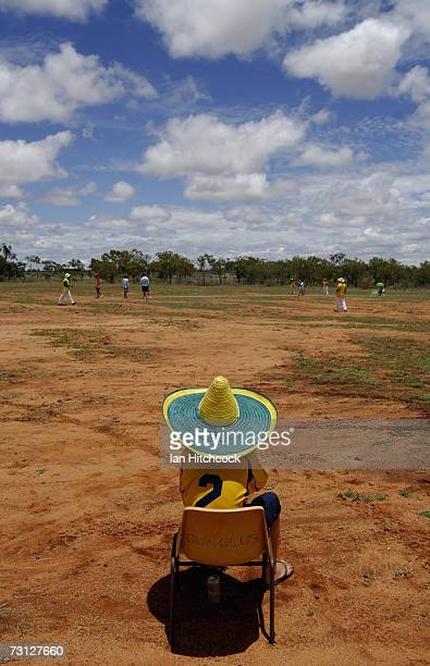 Spectator Brody Curran watches a social grade of cricket during the Goldfield Ashes January 27 2007 in Charters Towers Australia Due to heavy...