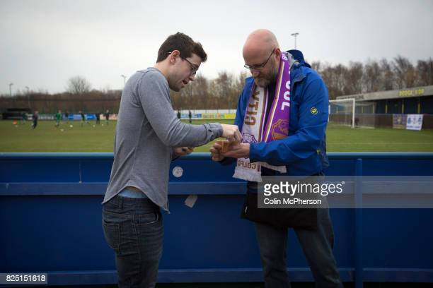 A spectator buying a 'golden goal' ticket at the Delta Taxis Stadium Bootle Merseyside before City of Liverpool hosted Holker Old Boys in a North...