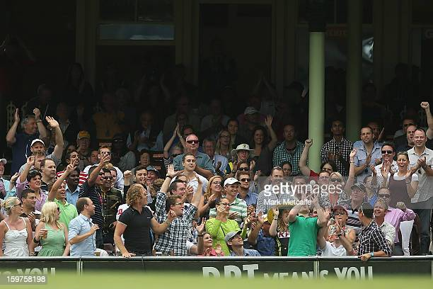 A spectator catches a ball during game four of the Commonwealth Bank one day international series between Australia and Sri Lanka at Sydney Cricket...