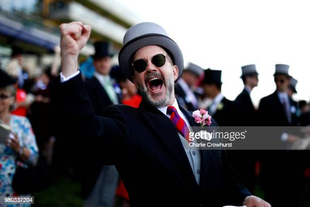 A spectator celebrates after backing the winner on day 3 of Royal Ascot at Ascot Racecourse on June 21 2018 in Ascot England