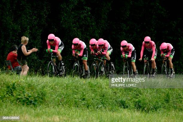 Spectator cheers as riders of USA's EF Education First - Drapac P/B - Cannondale cycling team compete during the third stage of the 70th edition of...