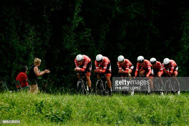 Spectator cheers as riders of USA's Trek - Segafredo cycling team compete during the third stage of the 70th edition of the Criterium du Dauphine...