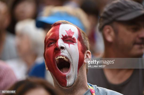 A spectator cheers for Canada's Milos Raonic ahead of his men's singles semifinal match against Britain's Andy Murray on day twelve of the 2016...