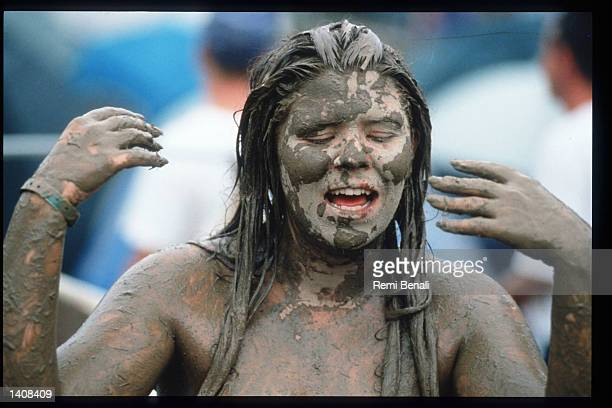 A spectator covered in mud attends the Woodstock 25th anniversary concert August 13 1994 at Winston Farm in Saugerties NY An international media...