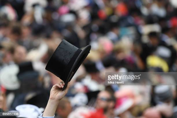 A spectator doffs his hat on Day Three of Royal Ascot at Ascot Racecourse on June 22 2017 in Ascot England