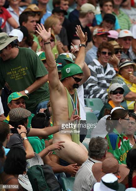 A spectator dressed as a South African version of movie character Borat entertains the crowd during day three of the First Test between South Africa...