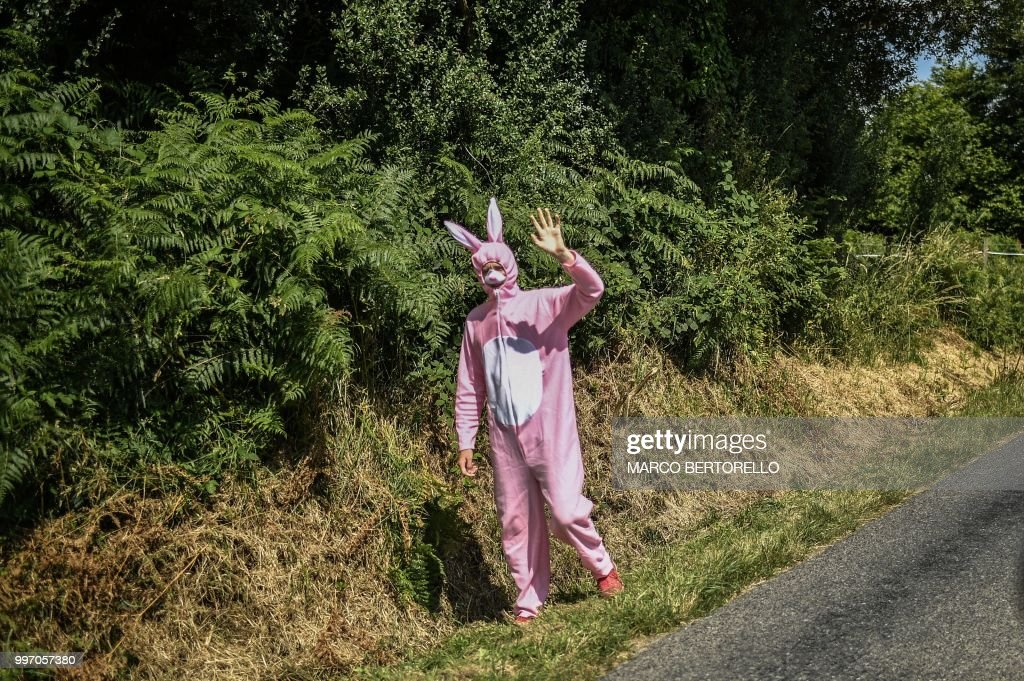 A spectator dressed up in a bunny rabbit fancy costume, waves during the sixth stage of the 105th edition of the Tour de France cycling race between Brest and Mur-de-Bretagne Guerledan, western France, on July 12, 2018.