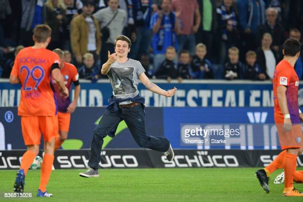 A spectator enters the pitch during the Second Bundesliga match between DSC Arminia Bielefeld and VfL Bochum 1848 at Schueco Arena on August 21 2017...