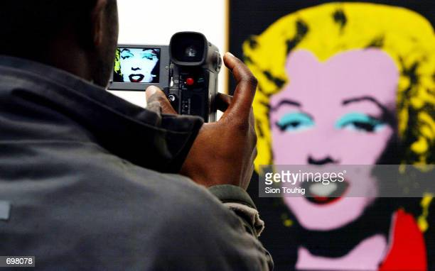"""Spectator films """"Licorice Marilyn"""" , a painting at the Andy Warhol retrospective exhibition February 5, 2002 at the Tate Modern Gallery in London...."""