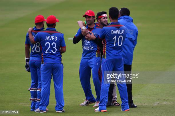 Spectator goes wild with excitement as he invades the pitch to get a photo with Asghar Stanikzai of Afghanistan during the MCC v Afghanistan cricket...