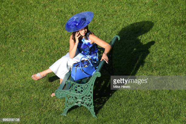 A spectator has a rest between races on Day Two of Royal Ascot at Ascot Racecourse on June 21 2017 in Ascot England