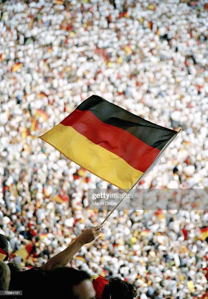 Spectator holding German flag at sports event : Stock-Foto