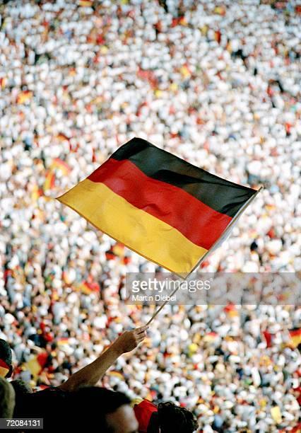 spectator holding german flag at sports event - internationale fußballveranstaltung stock-fotos und bilder