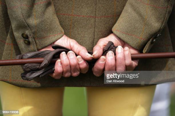 A spectator holds a riding whip during the first day of the Royal Windsor Horse Show on May 9 2018 in Windsor England The Royal Windsor Horse Show is...