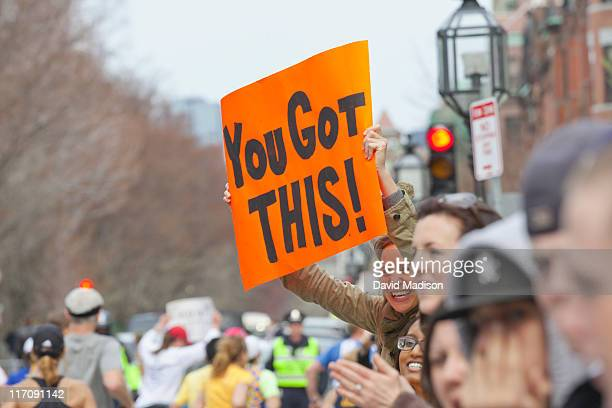 A spectator holds a sign on Commonwealth Avenue along the course of the 115th Boston Marathon on April 18 2011 in Boston Massachusetts