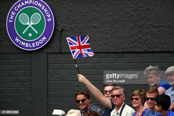A spectator holds a union flag during the Ladies Singles semi final match between Johanna Konta of Great Britain and Venus Williams of The United...