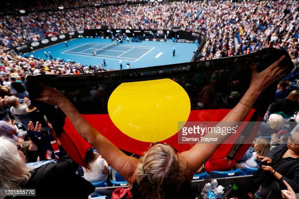Spectator in the crowd holds up an Indigenous flag after Ashleigh Barty of Australia wins her Women's Singles third round match against Elena...