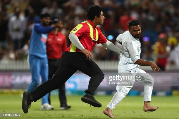 A spectator invades the pitch during the International T20 Game 3 between India and New Zealand at Seddon Park on February 10 2019 in Hamilton New...