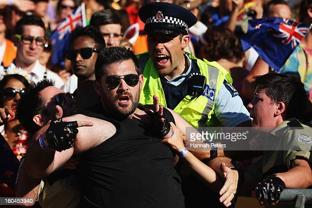 Spectator is arrested by police in the crowd during the 2013 Wellington Sevens at Westpac Stadium on February 1, 2013 in Wellington, New Zealand.