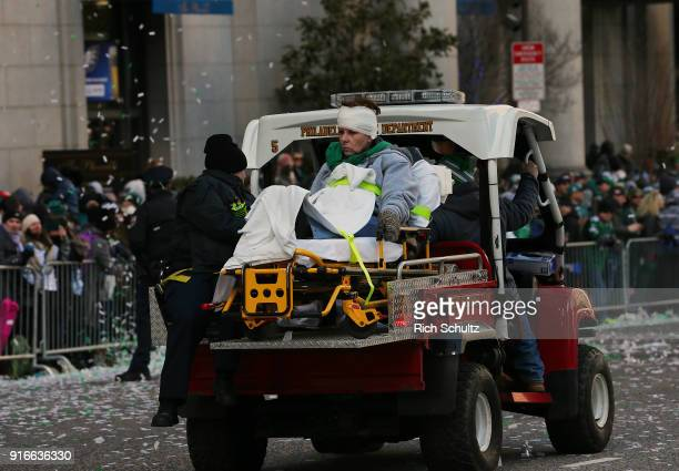 A spectator is carted away by peremedics during the Philadelphia Eagles Super Bowl Victory Parade on February 8 2018 in Philadelphia Pennsylvania