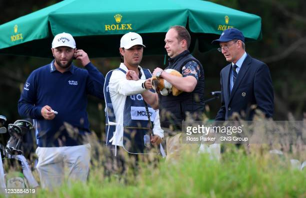 Spectator is removed after appearing to take Rory McIlroy's driver headcover during day two of the abrdn Scottish Open at the Renaissance Club on...