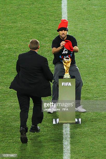 Spectator, Jimmy Jump, runs onto the pitch and tries to grab the World Cup before the 2010 FIFA World Cup South Africa Final match between...
