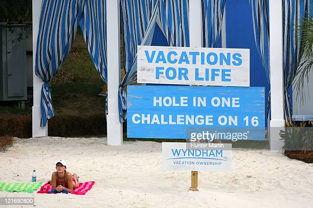 Spectator lays on the Wyndham beach along the 15th hole during the final round of the Wyndham Championship at Sedgefield Country Club on August 21,...