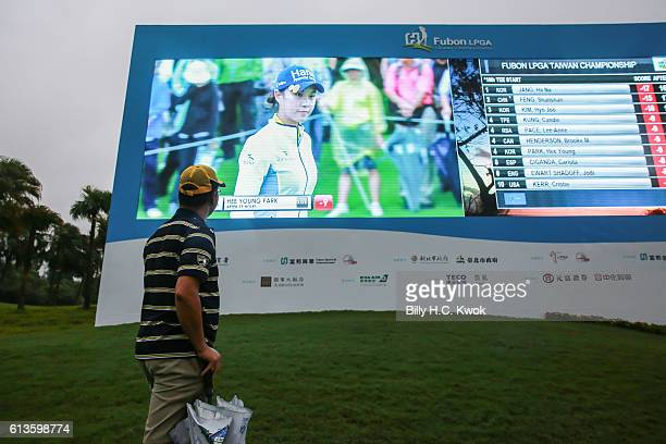 A spectator looks at the leader board in the Fubon Taiwan LPGA Championship on October 9 2016 in Taipei Taiwan