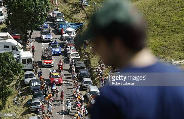 Spectator looks on, as the lead group is in the last climb leading to the Col de Peyresourde during stage fourteen between Saint-Girons and...