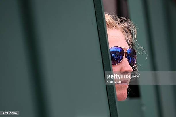 A spectator looks on during a match on day 7 of the Wimbledon Lawn Tennis Championships at the All England Lawn Tennis and Croquet Club on July 6...
