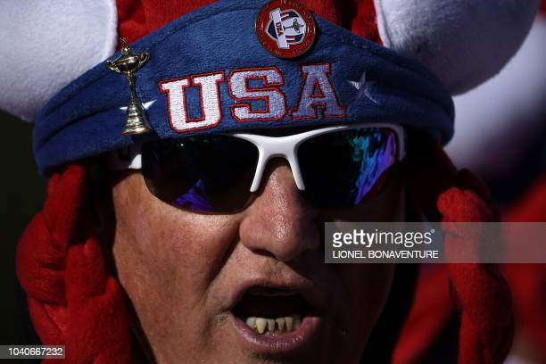 A spectator looks on during a practice session ahead of the 42nd Ryder Cup at Le Golf National Course at SaintQuentinenYvelines southwest of Paris on...