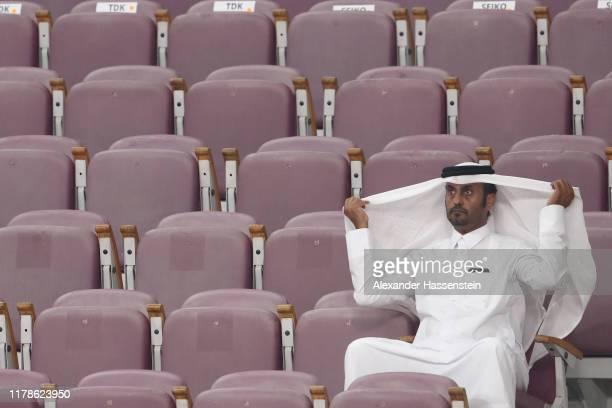 A spectator looks on during day six of 17th IAAF World Athletics Championships Doha 2019 at Khalifa International Stadium on October 02 2019 in Doha...