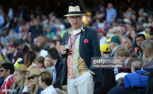 A spectator looks on during the third day of the second Ashes cricket test match between Australia and England at the Adelaide Oval on December 4...