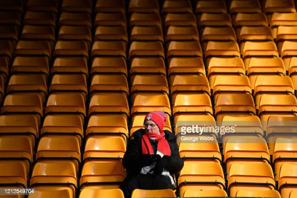 A spectator looks on from inside the ground prior to kick off during the Betfred Super League match between Castleford Tigers and St Helens at The...