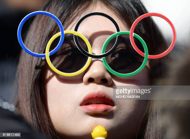 Spectator looks on in the mens's skeleton heat 4 final run during the Pyeongchang 2018 Winter Olympic Games, at the Olympic Sliding Centre on...