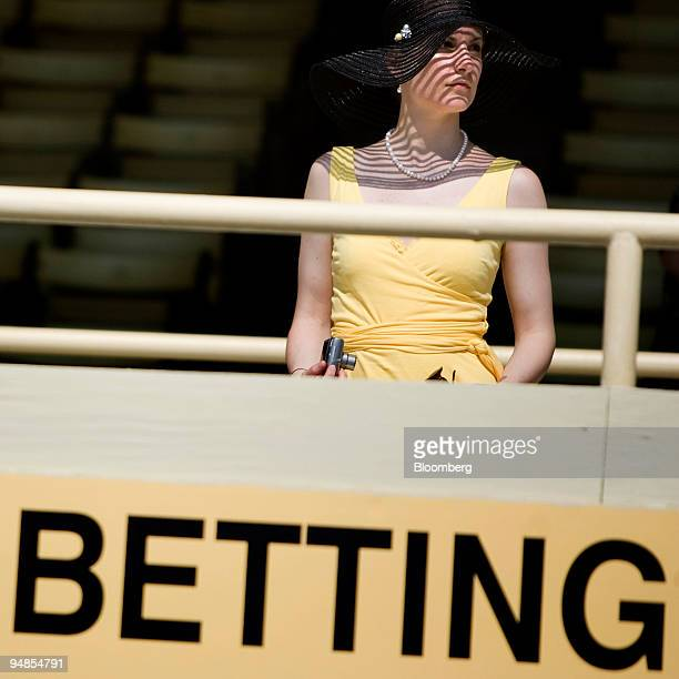 A spectator looks out from the grand stands before the 133rd Preakness Stakes at Pimlico Race Course in Baltimore Maryland US on Saturday May 17 2008...