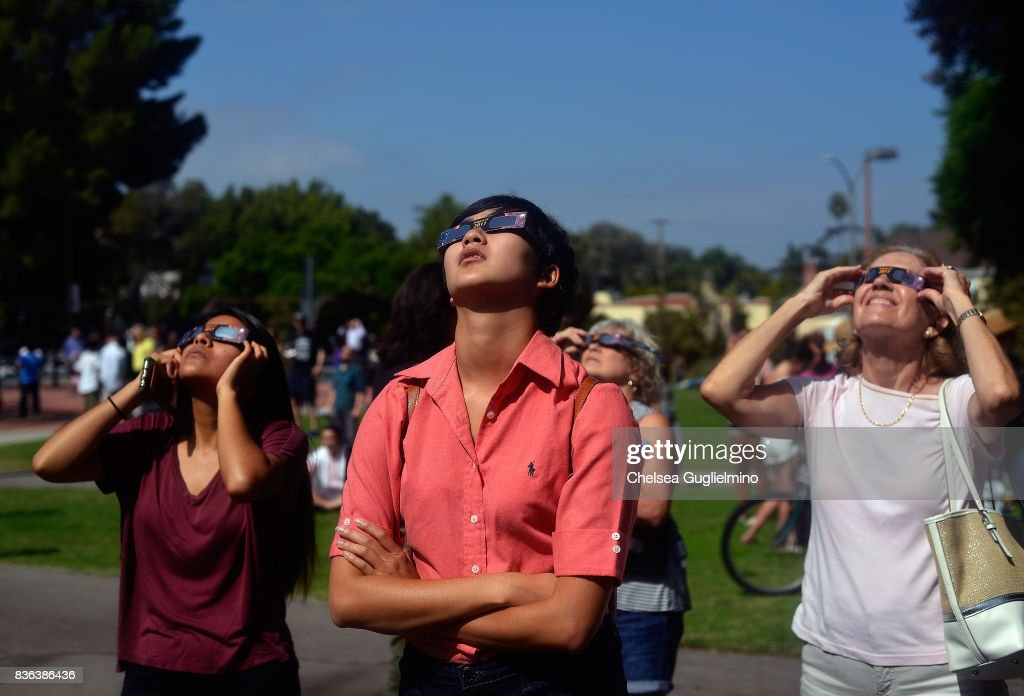 A spectator looks skyward during the partial solar eclipse at peak time on August 21, 2017 in Los Angeles, California.