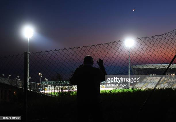 Spectator looks through a fence into the stadium prior to the UEFA Nations League A Group Four match between Croatia and England at Stadion HNK...
