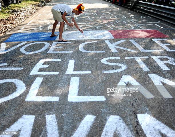 Spectator paints on the road during stage fifteen of the 2013 Tour de France a 2425KM road stage from Givors to Mont Ventoux on July 14 2013 on Mont...
