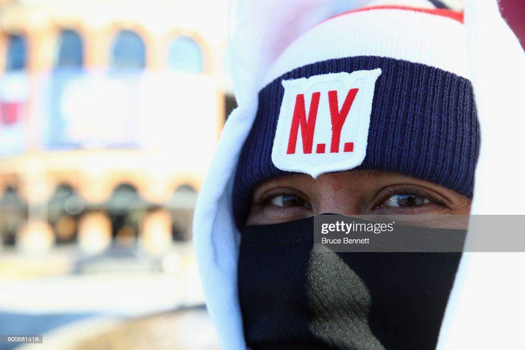 A spectator poses outside the stadium prior to the game between the Buffalo Sabres and the New York Rangers in the 2018 Bridgestone NHL Winter Classic at Citi Field on January 1, 2018 in Flushing neighborhood of the Queens borough of New York City, New York. The Rangers defeated the Sabres 3-2 in overtime.