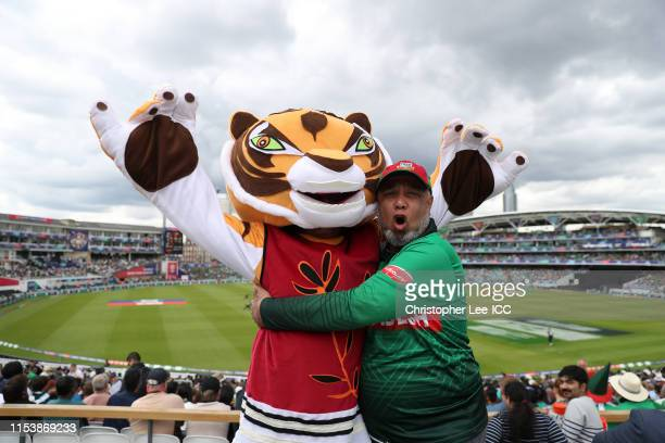 A spectator poses with a Bangladesh fan for a photo in fancy dress during the Group Stage match of the ICC Cricket World Cup 2019 between Bangladesh...