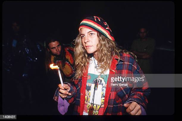 Spectator prepares to smoke pot at the Woodstock 25th anniversary concert August 13, 1994 at Winston Farm in Saugerties, NY. An international media...