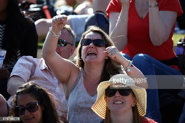 A spectator reacts as Andy Murray of Great Britain plays Ivo Karlovic of Croatia in their Gentlemen's Singles Fourth Round match on day 7 of the...